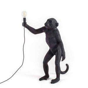 czarna lampa małpa stojąca