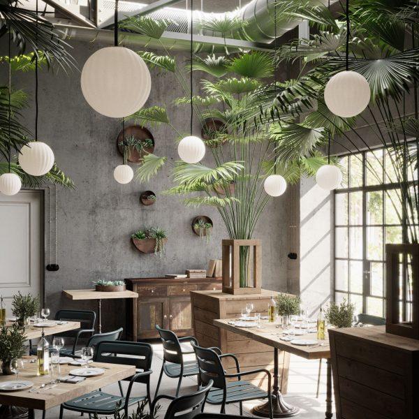wiele lamp modeco w roślinnym wnętrzu