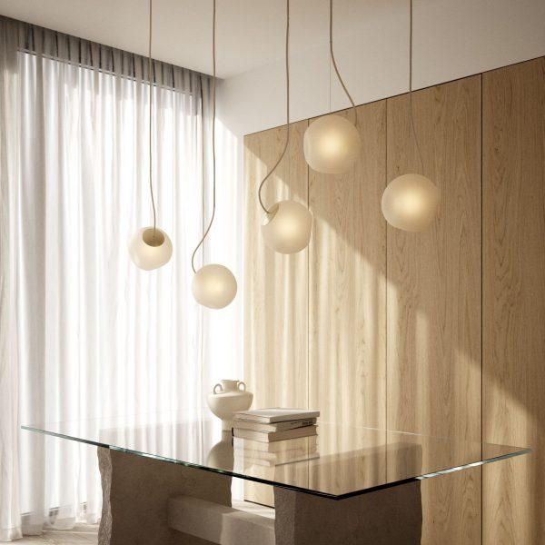 lampy kule bright barocco nad szklanym stołem